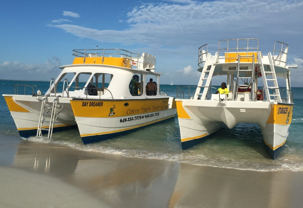 Turks and Caicos double deck boats for tours on beach